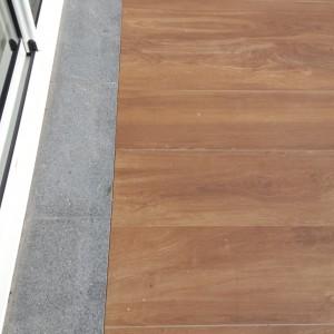 dalle en recouvrement d'un seuil à Ornans par l'entreprise Cuinet